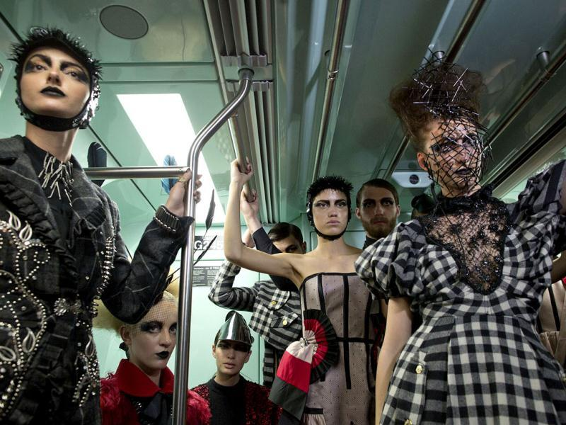 Models wearing collections of previous editions of the Sao Paulo Fashion Week, ride a subway train in Sao Paulo, Brazil. (AP Photo)