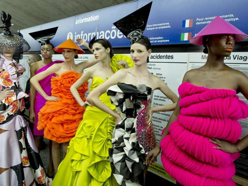 Models wearing collections of previous editions of the Sao Paulo Fashion Week, stand inside a subway station in Sao Paulo, Brazil. (AP Photo)