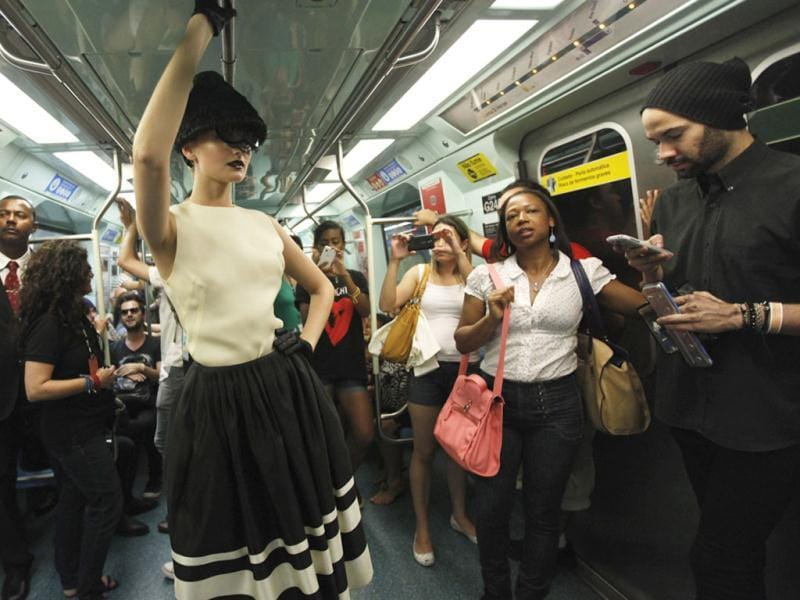 A model presents a creation on a train in a subway station during the Sao Paulo Fashion Week in Sao Paulo. (Reuters)