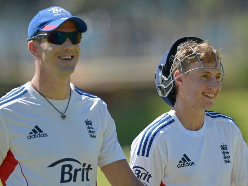 England Ashes Test cricketers Kevin Pietersen and Joe Root walk off the field during a training session at a suburban cricket ground near Perth. (AFP Photo)
