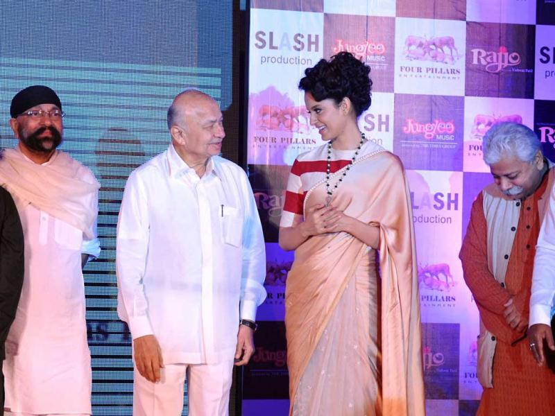 Union Home Minister Sushil Kumar Shinde chats with Kangana Ranaut during the music launch.