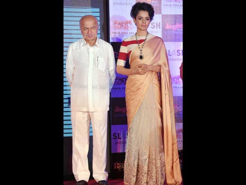 Bollywood actress Kangana Ranaut and Union Home Minister Sushil Kumar Shinde pose for shutterbugs during the music launch.