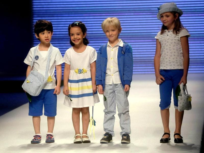 Young models parade creations from the 1001 Nights Yeye Children's Collection during China Fashion Week in Beijing. (AFP photo)