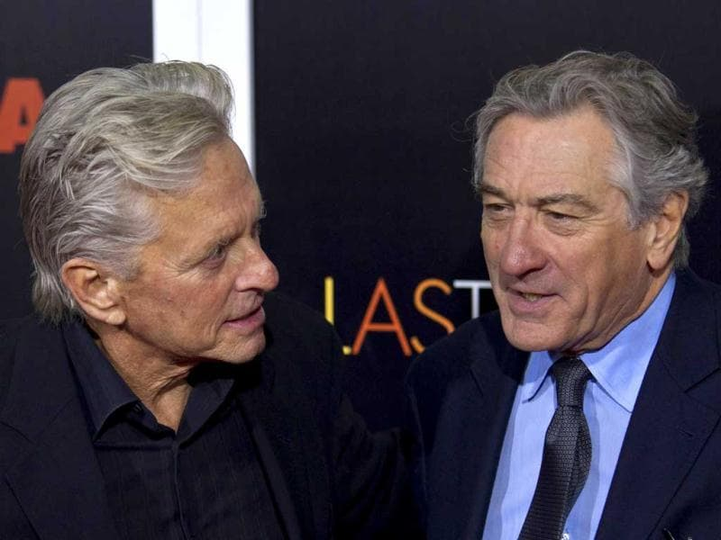 Actors Michael Douglas and Robert De Niro talk while they attend the premiere of the movie Last Vegas in New York. (Reuters Photo)