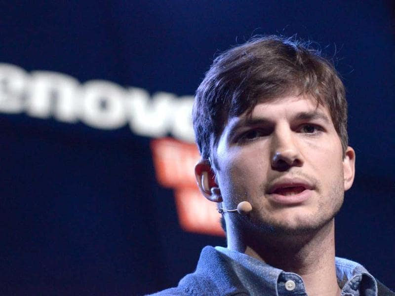 US actor Ashton Kutcher presents Lenovo's first multi mode tablet Yoga Tablet during Lenovo, a Chinese computer maker, press conference at Youtube Space in Los Angeles. (AFP Photo)