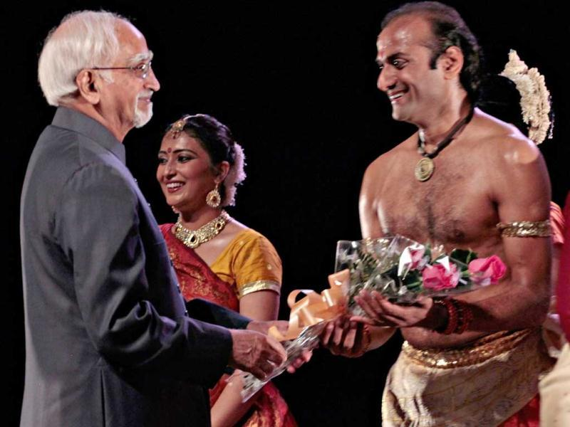 Vice President Hamid Ansari interacts with artists of the Sangeet Natak Academy after a show in Havana. Ansari is in Cuba on a two-day official visit. (Reuters photo)