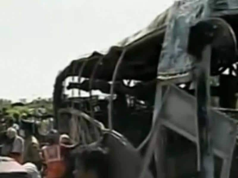 A private bus, carrying about 49 passengers, caught fire after hitting a roadside barrier in Mehaboobnagar, Andhra Pradesh. (TV grab)