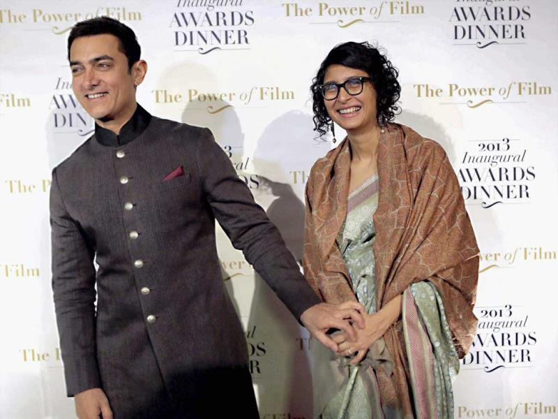 Bollywood actor Aamir Khan with wife Kiran Rao at America Abroad Media's 2013 Inaugural Awards Gala Dinner in Washington on Monday. (PTI)