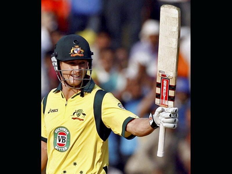 Australian batsman George Bailey celebrates his century during their 6th ODI cricket match against India in Nagpur. (PTI Photo)