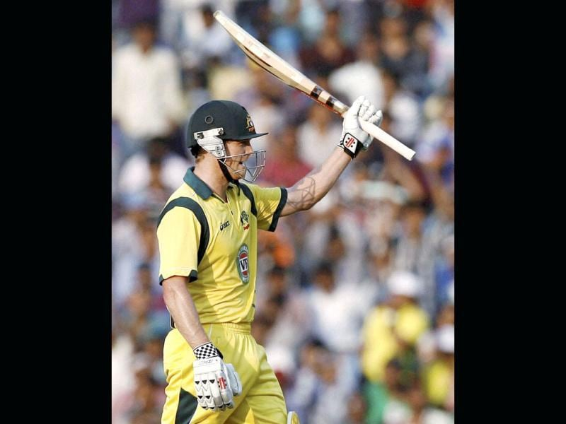Australian batsman George Bailey celebrates after completing 150 runs during their 6th ODI cricket match against India in Nagpur. (PTI Photo)
