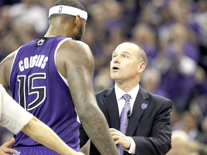 Sacramento Kings head coach Michael Malone, right, talks with Kings center DeMarcus Cousins (15) during an NBA basketball game against the Denver Nuggets, in Sacramento, Calif. The Kings won 90-88. AP Photo