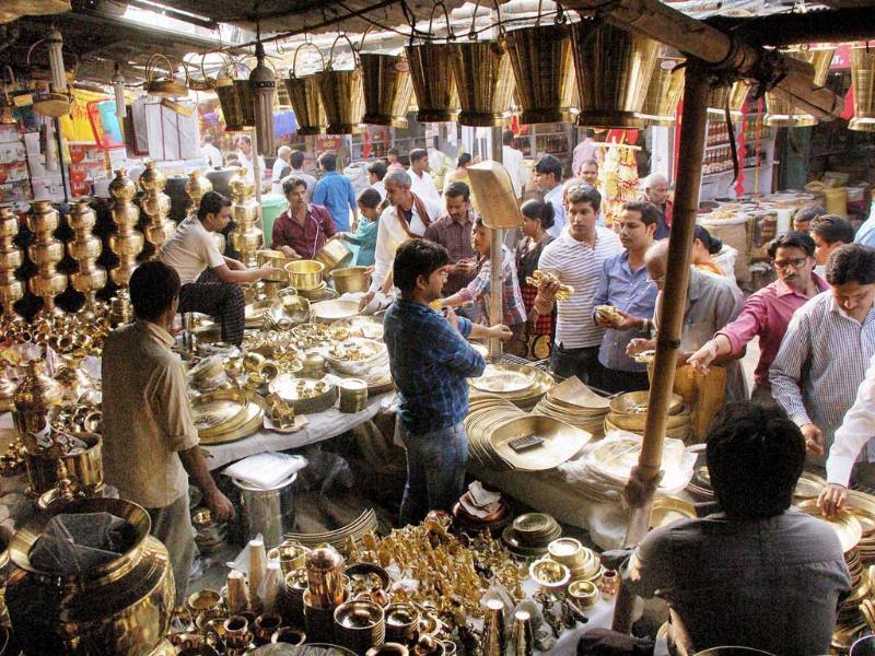 People buy metal pots on the occasion of Dhanteras festival in Patna. (PTI Photo)