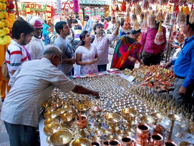 People were busy buying pots and garlands for Dhanteras festival in Guwahati. (PTI Photo)