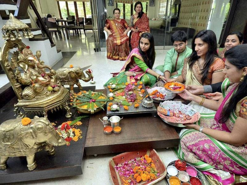 Women perform Ganesh puja on the occasion of Dhanteras festival in Ahmedabad. (PTI Photo)