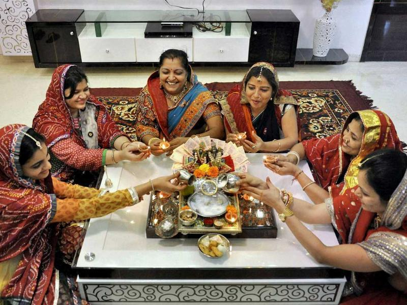 Housewives perform Laxmi puja on the occasion of Dhanteras in Surat. (PTI Photo)