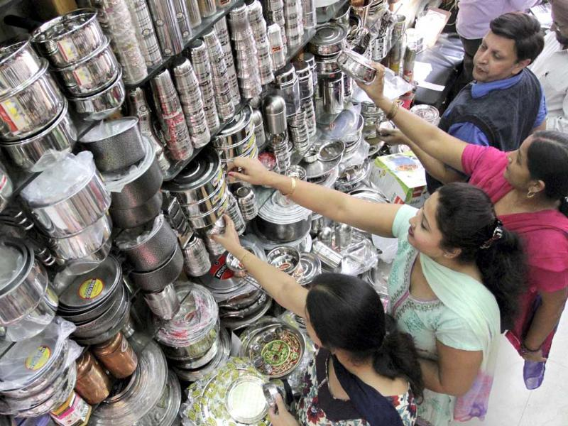 Women buy utensils at a market on the occasion of Dhanteras festival in Jammu. (PTI Photo)