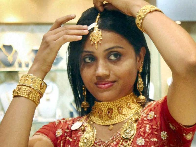 A woman with gold ornaments at a jewellery shop on the occasion of Dhanteras in Jamshedpur. (PTI Photo)