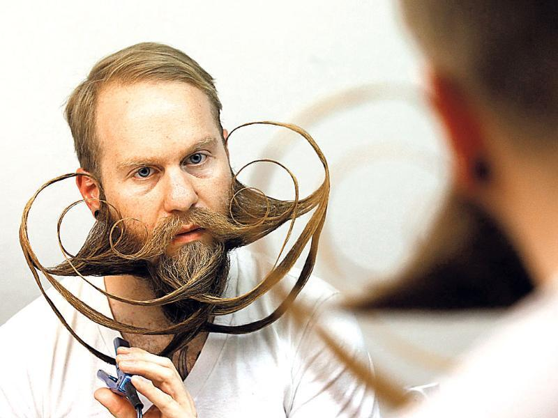 Participant Justin Kellermeier of the US styles his beard for the Beard World Championship 2013 in Leinfelden-Echterdingen, Germany. (Reuters Photo)