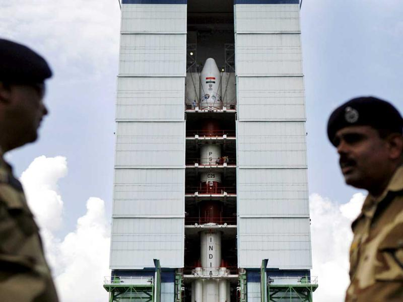 Central Industrial Security Force personnel stand guard near the PSLV-C25 at the Satish Dhawan Space Center at Sriharikota. (AP photo)