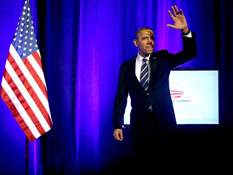 US President Barack Obama takes the stage to deliver remarks on the Affordable Care Act, commonly known as Obamacare, at an Organizing for Action grassroots supporter event in Washington. (Reuters)
