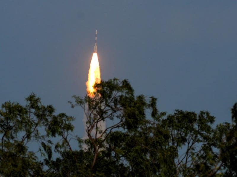 PSLV-C25 launch vehicle carrying the Mars Orbiter probe as its payload moments after lift-off, in Sriharikota. With Mangalyaan's successful launch, India joined the US, European Space Agency and the former Soviet Union in the elite club of Martian explorers. (HT Photo/Nathan G)