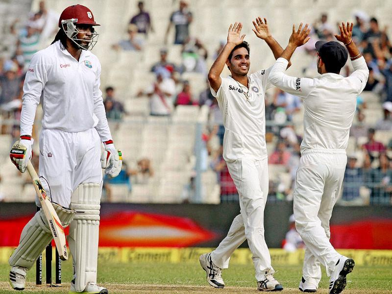 Medium pacer Bhuvneshwar Kumar celebrates after dismissing West Indies opener Chris Gayle at Eden Garden in Kolkata. (PTI photo)