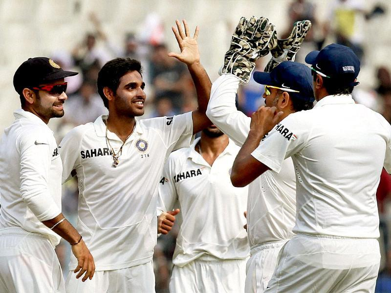 Medium pacer Bhuvneshwar Kumar celebrates with his team after dismissing West Indies opener Chris Gayle at Eden Garden in Kolkata. (PTI photo)