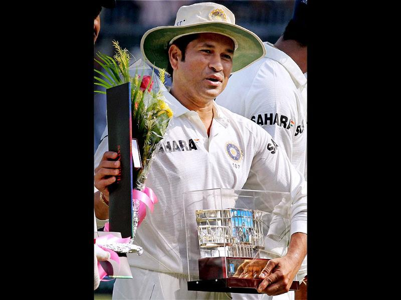 The Cricket Association of Bengal felicitated Sachin Tendulkar on his 199th test match against West Indies at Eden Garden in Kolkata. (PTI photo)