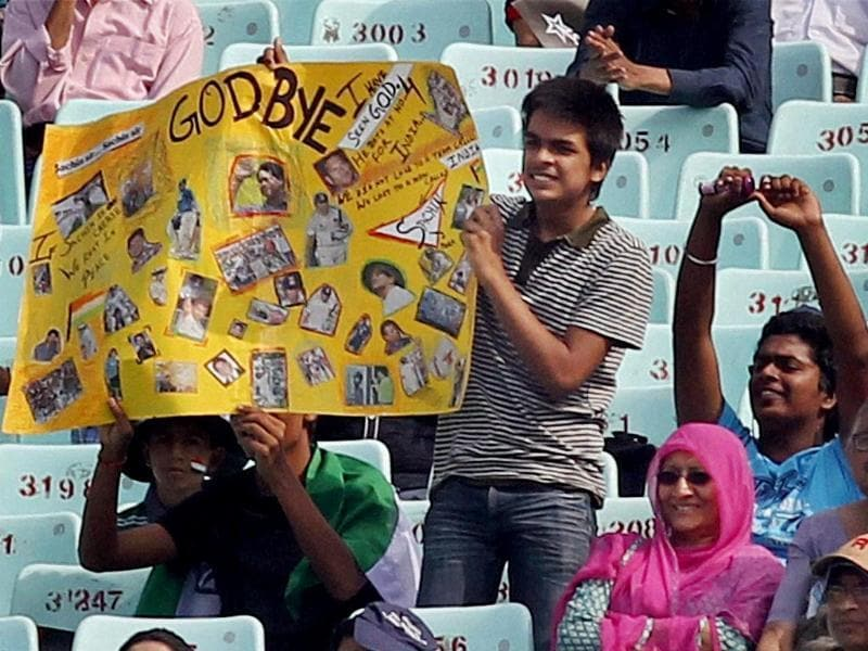 Sachin Tendulkar's fans hold his posters during the first test match between India and West Indies at Eden Garden in Kolkata. (PTI photo)
