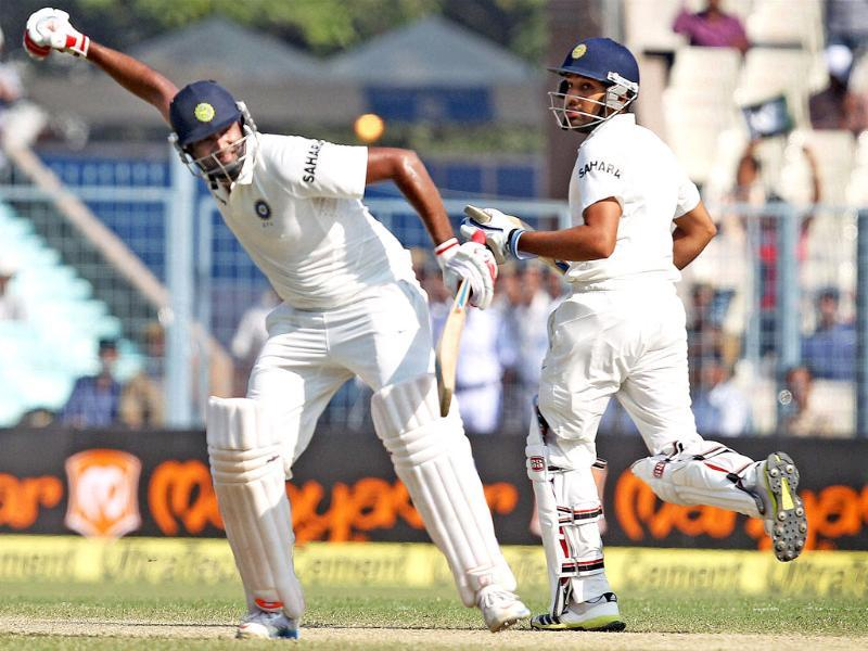 Ravichandran Ashwin celebrates his century as Rohit Sharma looks on, during the third day of the first Test match against West Indies at the Eden Gardens in Kolkata. (PTI Photo)