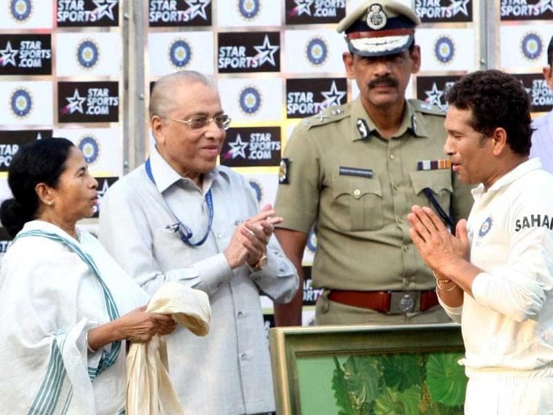 West Bengal chief minister Mamata Banerjee honours master blaster Sachin Tendulkar at the presentation ceremony after the end of the first Test match against West Indies at Eden Garden in Kolkata. (PTI Photo)