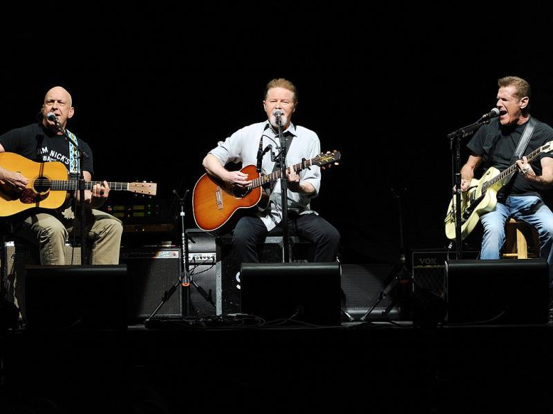 Musicians Bernie Leadon, left, Don Henley and Glenn Frey, right, of the Eagles perform at Madison Square Garden in New York. (AP photo)