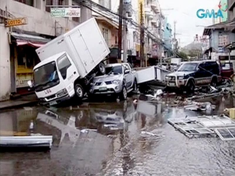 Piled up vehicles are pictured on a flooded street filled with debris after Typhoon Haiyan hit the central Philippine city of Tacloban, Leyte province in this still image from video November 8, 2013. (Reuters)