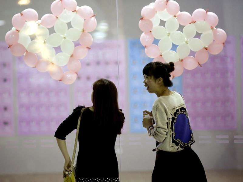Participants take part in a mass match-making event ahead of Singles Day in Shanghai, China. (AP Photo)