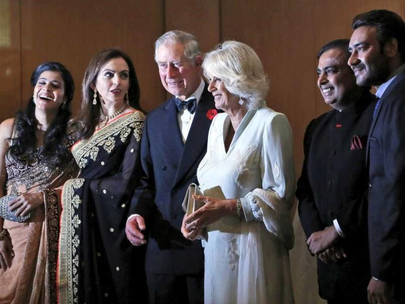 Britain's Prince Charles and his wife Camilla, the Duchess of Cornwall, stand with Bollywood actress Kajol, left, businesswoman Nita Ambani, second left, industrialist Mukesh Ambani, second right, and Bollywood actor Ajay Devgan before a dinner to support the work of British Asian Trust in Mumbai, India, Saturday, Nov. 9, 2013. (AP Photo)