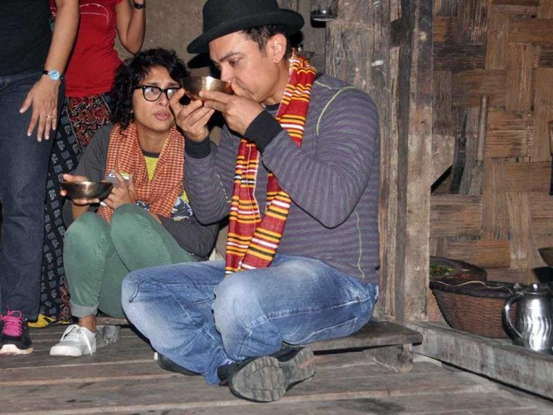 Aamir Khan and Kiran Rao were spotted in Assam recently. The couple was there to celebrate Kiran's 40th birthday. In the image, they sip a tribal rice brew of Assam, locally known as 'apong', sitting on a bamboo house-on-stilts in a village in Assam. Browse through for more