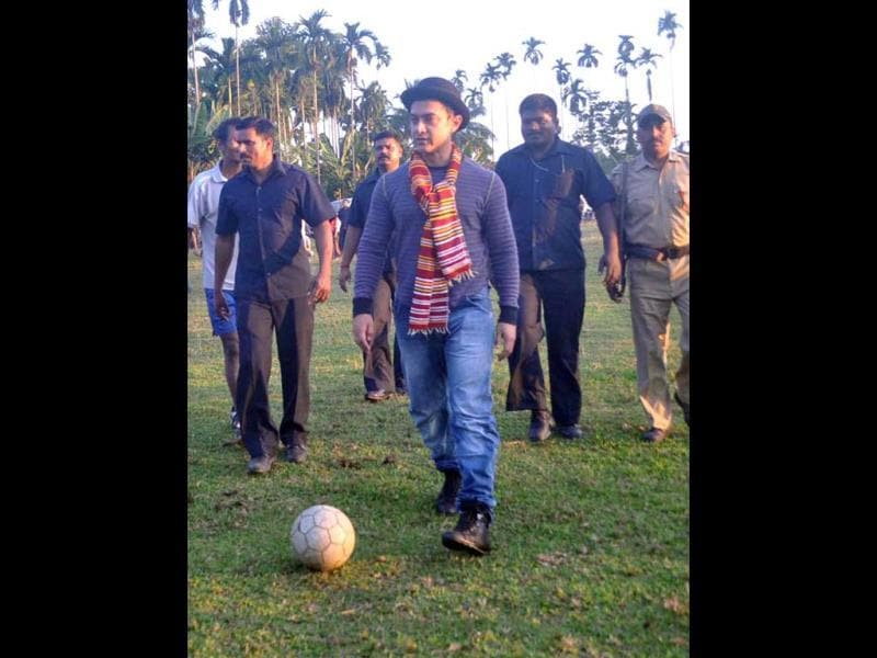 An enthusiastic Aamir trying his hand on a football session in Assam