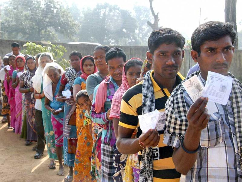 A file phote of people waiting to cast their votes at a polling booth in Dantewada during the Chhattisgarh assembly elections. (PTI photo)