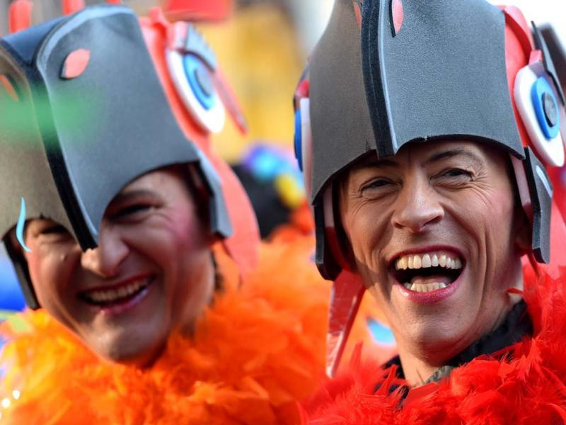 Masqueraded revellers celebrate the start of the carnival season in the western German city of Duesseldorf. (AFP Photo)