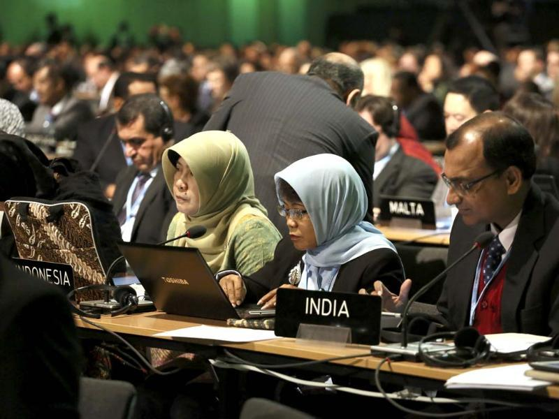 Delegates from Indonesia and India attend the 19th conference of the United Nations Framework Convention on Climate Change (COP19)in Warsaw. (Reuters Photo)