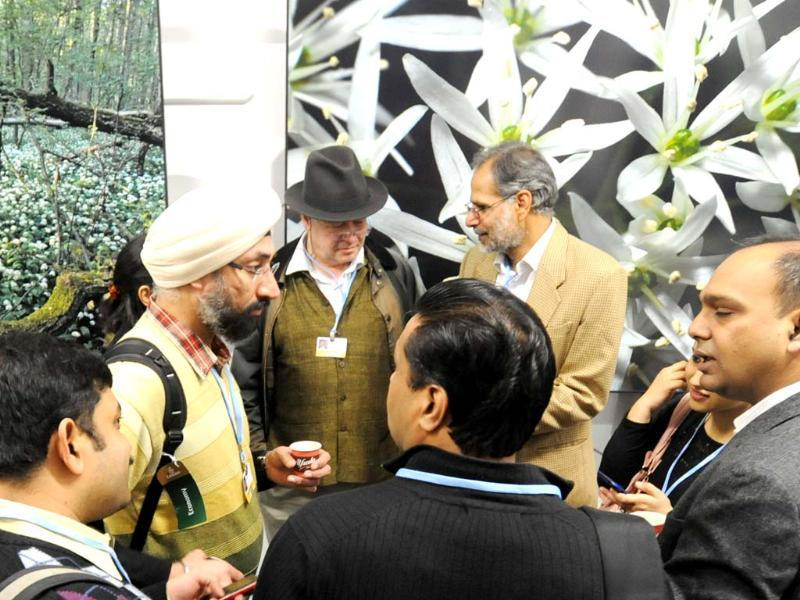 Indian delegates chat at the opening of the conference in Warsaw, Poland, where, thousands of participants from around the world for climate talks. (AP Photo)