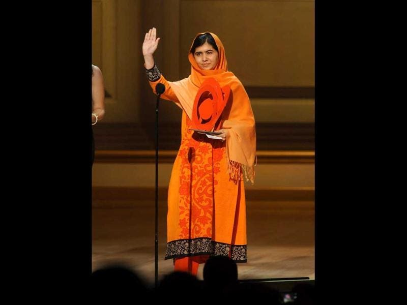 Malala Yousafzai accepts The Women of the Year Fund Honoree Award on stage at the 2013 Glamour Women of the Year Awards in New York. (AP Photo)