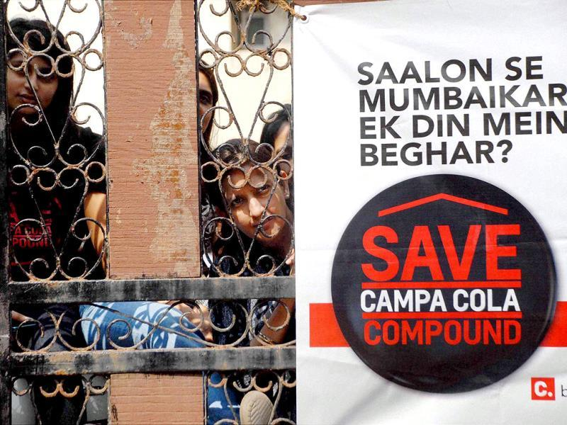 Residents of Campa Cola Compound protest against the demolition of their houses in Mumbai. PTI
