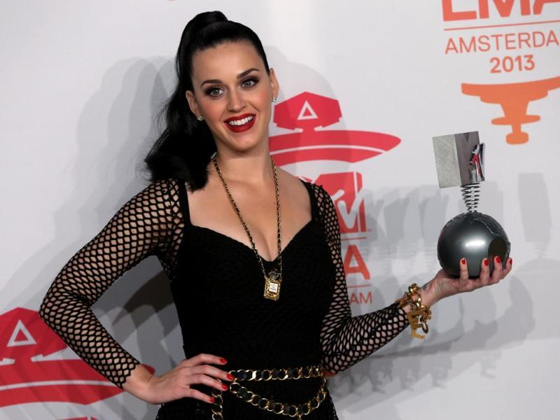 Katy Perry poses for photographers backstage with her award for Best Female at the 2013 MTV Europe Music Awards, in Amsterdam, Netherlands. (AP Photo)