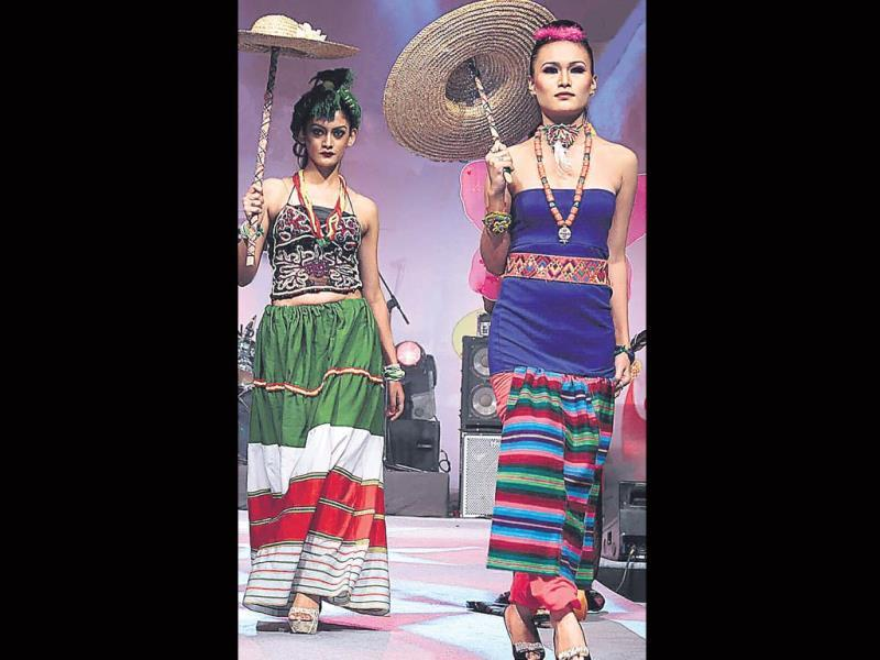 Models display regional outfits. Check out the fusion of modern and ethnic designs.