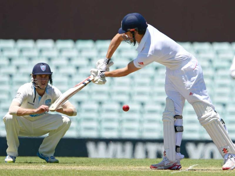 England Ashes Test cricket captain Alastair Cook (R) plays the ball past close-in fieldsman Kurtis Patterson (L) during the tour match against a Cricket Australia Invitational XI in Sydney. (AFP Photo)