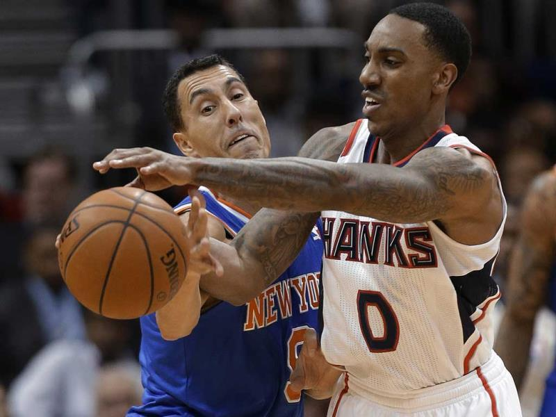 New York Knicks guard Pablo Prigioni (9) knocks the ball away from Atlanta Hawks guard Jeff Teague (0) in the second half of an NBA basketball game in Atlanta. (AP Photo)