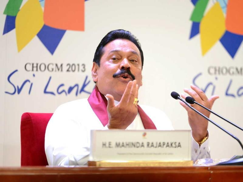 Sri Lankan President Mahindra Rajapakse speaks during a press conference in Colombo, ahead of Commonwealth summit. (AFP Photo)