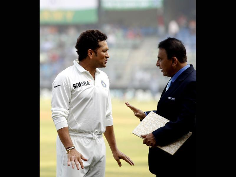 The 'Litte Master' Sunil Gavaskar greets the 'Master Blaster' Sachin Tendulkar during the release of the postal stamp honouring the latter on his final Test match against West Indies at Wankhede Stadium. (Ajay Aggarwal/ HT photo)