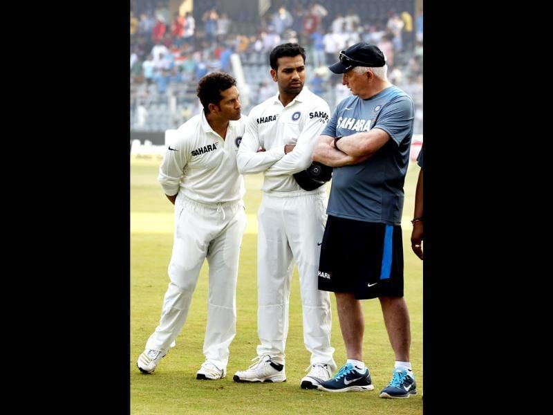 Sachin Tendulkar with Rohit Sharma and coach Duncan Fletcher on his final Test match against West Indies at Wankhede Stadium in Mumbai. (Ajay Aggarwal/ HT photo)